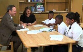 Children around desk after school poetry program