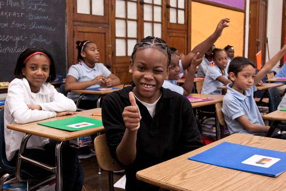 Child giving thumbs up in after school program - Detroit