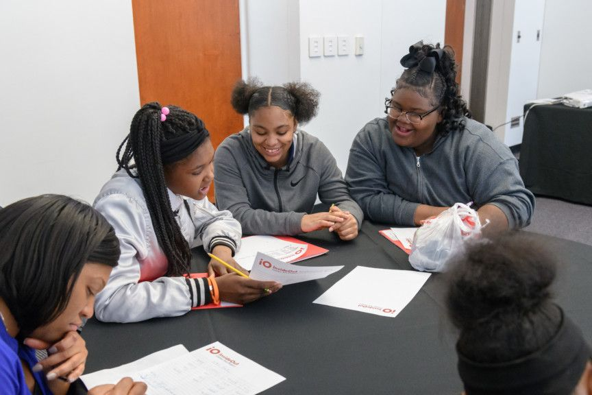 Students writing at a table